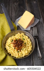 Cheese spaetzle on wood background