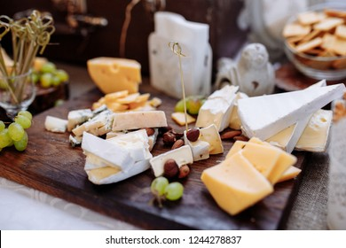 Cheese table. Delicious kinds of cheese. Buffet with cheese board