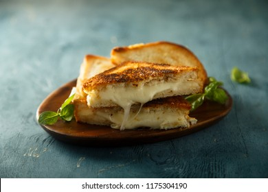 Cheese toasts on the wooden desk