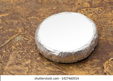 Cheese top hat in silver foil mockup. mockup for burger, butter and other products. Brown background. Product template