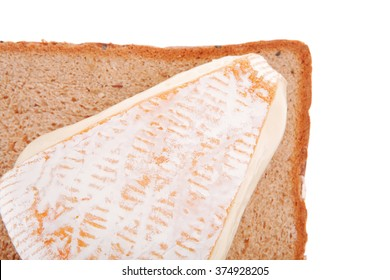 cheese triangle on bread over white background