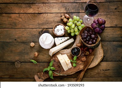 Cheese variety. Food background.  Fresh ingredients on wood