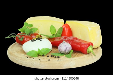 Cheese and vegetables on black background