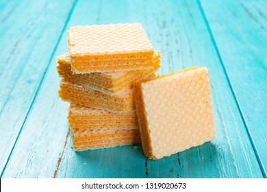 cheese wafer blocks stacked on blue background