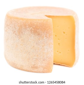 Cheese wheel isolated on white background