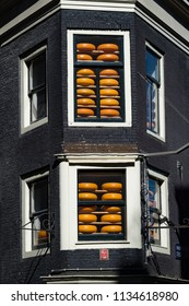 Cheese wheels stacked in a  window in Amsterdam, Netherlands