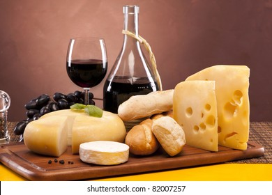 Cheese and wine composition on wooden table