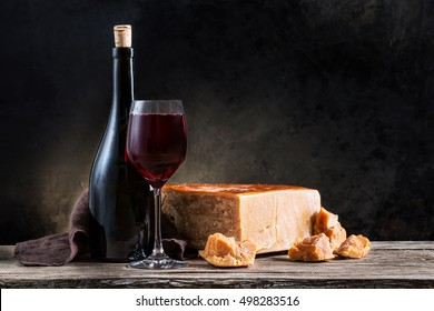 cheese and wine on old wooden table