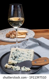 Cheese and wine pairing, french soft blue roquefort cheese and sweet white sauternes wine from Bordeaux, France, close up