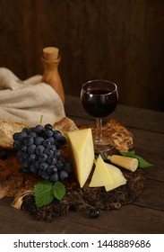 cheeseboard on a wooden table, rustic style