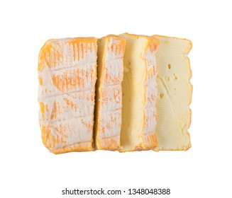 Cheeseboard with Sliced Yellow Limburger Cheese Close Up and Top View. Herve or Reblochon Isolated on White Background with Clipping Path