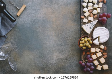 Cheeseboard with various cheeses, grapes, olives and nuts