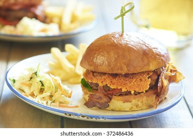 Cheeseburger with cheddar chips, tomato and fried bacon