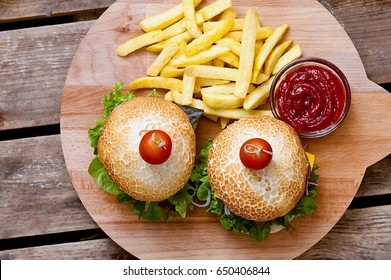 Cheeseburger with cheese, salad and cucumber