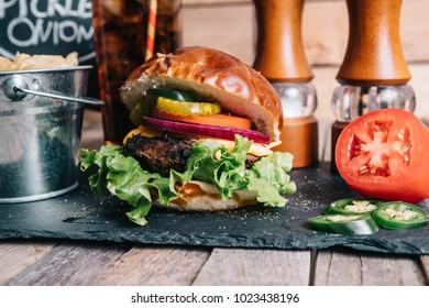 Cheeseburger on a Pretzel Bun With Soft Drink