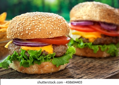 Cheeseburgers on wooden table with copy space