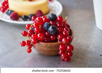 Cheesecake cake with red currant berries and a white mug