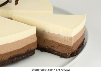 Cheesecake with chocolate on light background