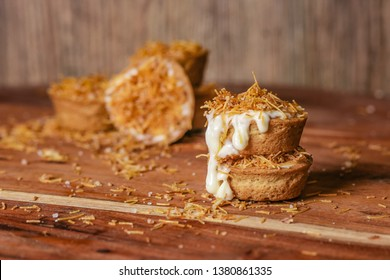 Cheesecake cookie cups baked in a muffin tin. Homemade cookies with cream cheese filling and kataifi dough on the top. Traditional Middle Eastern dessert. - Image