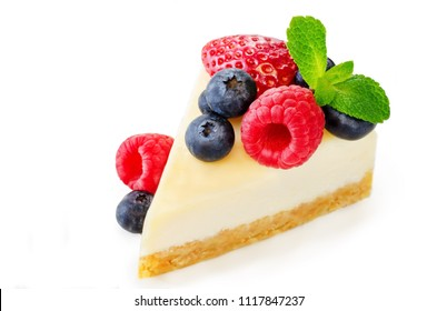 Cheesecake with fresh berries and mint leaves isolated. the toning. selective focus