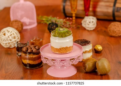 cheesecake in a jar with tropical fruits  kiwi slices