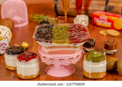 cheesecake in a jar with tropical fruits  kiwi,Mango,Strawberry,Banana, Peach slices