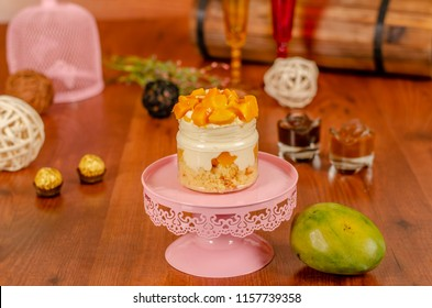 cheesecake in a jar with tropical fruits  mango