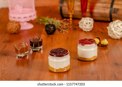 cheesecake in a jar with tropical fruits  Raspberry