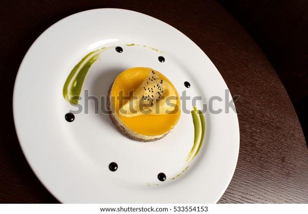 Cheesecake Maracuja on the big round white plate
