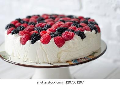 Cheesecake on agar with raspberries and blackberries