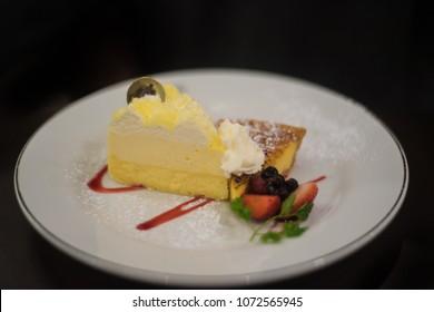 Cheesecake on dark background