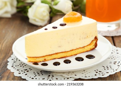 Cheesecake on the plate on brown wooden background