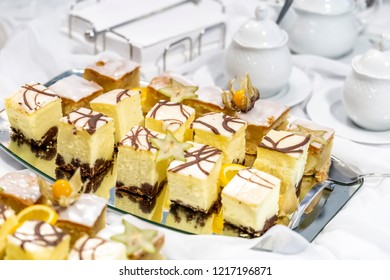 Cheesecake in pieces on a mirrored tray