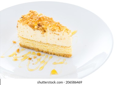 Cheesecake slice with almond on top isolated on white background