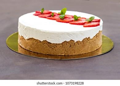 Cheesecake with strawberries. Cake decorated with strawberries.  Delicious cheesecake decorated with fresh strawberries.  New York cheesecake.