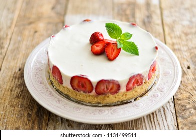 Cheesecake with strawberries on white background