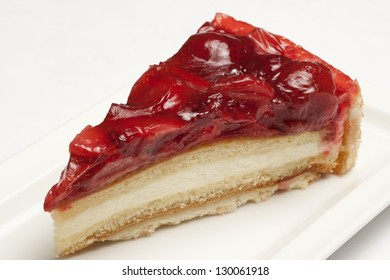Cheesecake with strawberry topping on a white plate