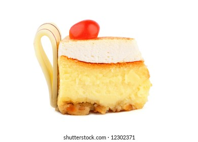 cheesecake with a sweet red cherry and chocolate tapes: milk and white