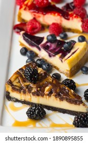 Cheesecake. Traditional Classic New York Style cheesecake dessert topped with fresh starwberry and a a strawberry sauce. A bakery or pastry shop favorite.