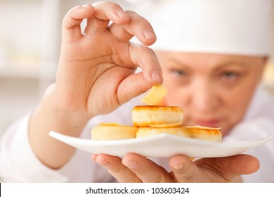 cheesecakes on a white platter and cheese