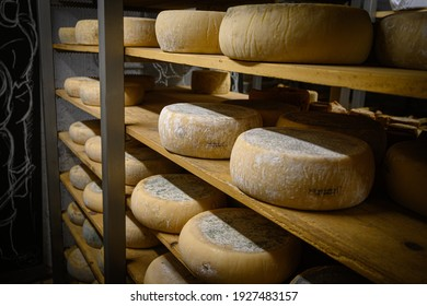 cheeses maturing in a dark and damp cellar