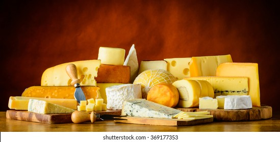 Lot of cheeses in still life, hard-cheese, soft-cheese, emmental