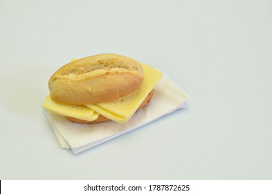 cheesesandwich on white napkin, closeup, isolated on white background