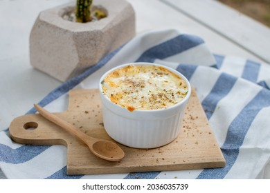 cheessy baked spinach in white ceramic cup