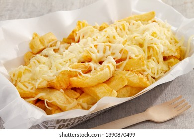 cheesy chips in take away tray
