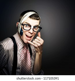 Cheesy Customer Service Call Center Operator Using Inventive Telephone Headset While Cold Calling People In A Depiction Of Telemarketing