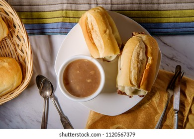 Cheesy French dip beef sandwich with melted provolone cheese