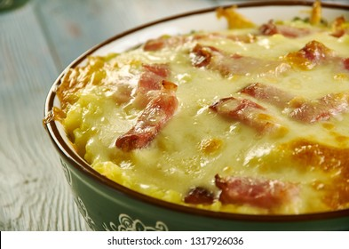 Cheesy Ham and Hash Brown Casserole,  large bowl, mix together hash browns, ham, cream of potato soup, sour cream, and cheddar cheese