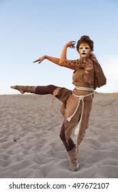 Cheetah woman dances in desert