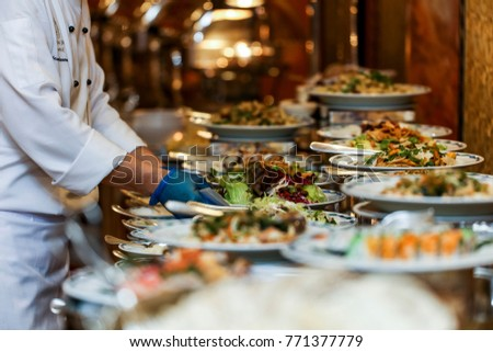 Chef arranging food on buffet table stock photo edit now 771377779 chef is arranging the food on buffet table watchthetrailerfo
